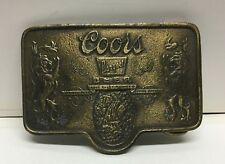 "[64701] OLD COORS BANQUET BELT BUCKLE - MEASURES 3 1/8"" Long x 2 1/4"" High"