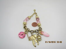 BRACELET BIJOUX TERNER SIGNED GOLD TONE WITH PINK CHARMS,KEY,BOW METAL