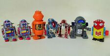 NOVELTY MECHANICAL ASSORTED SPACE ROBOT LOT WITH 7 WIND UP TOY