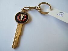 PONTIAC GOLD PLATED  UNCUT KEY BLANK WITH KEY CHAIN