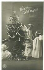 """GERMANY: CHRISTMAS RPPC. """"FROHLICHE WEIHNACHLEN"""" CHILD ANGELS, TOYS. DECORATED T"""