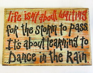 Life isn't about waiting for storm to pass, it's learning to Dance in Rain sign