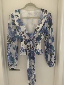SHEIKE floral Blouse. Size 6 (also fits small size 8)