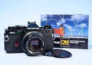 Olympus OM2 Spot Program SLR 35mm Film Camera 50mm f1.8 Lens * Working NEW SEALS