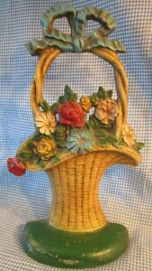 """Old vintage CAST IRON DOORSTOP ~ colorful flower basket w/ bow ~ 10  1/2"""" tall"""