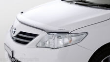 TOYOTA COROLLA HEADLAMP COVERS SEDAN ZRE152 APRIL 2010> NEW GENUINE