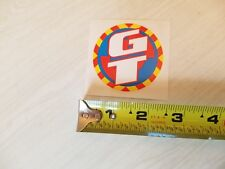 1990 GT smaller  coin decal Perforer old school bmx blue red yellow on clear