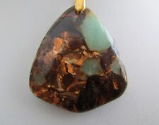 A GREEN JASPER & COPPER/GOLD PENDANT ON A CORD NECKLACE. (75*)