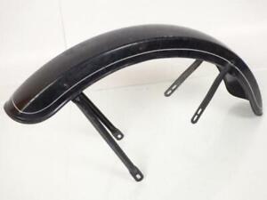 Garde boue avant en métal coloris noir avec  liseret blanc d'occasion pour moto