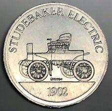 # C8565    SUNOCO  ANTIQUE CAR   ALUMINUM  TOKEN,  1902   STUDEBAKER ELECTRIC