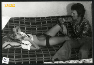 pretty girl and boyfriend smiling on bed, flares,   Vintage Photograph, 1970'
