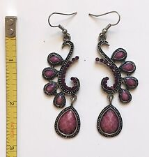 Fun and flirty pink costume dangler earrings