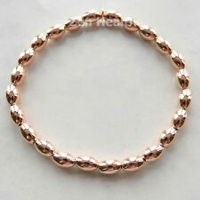 Beautiful Shiny Rose Gold Plated and Silver Oval Bead Stretch Bracelet