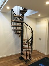 Wrought Iron spiral staircase Plain balustrade with timber thread 1250 Diameter