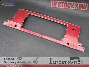 TOYOTA A70 SUPRA USED REAR NUMBER PLATE SURROUND METAL PANEL -RED TRIM BRACKET