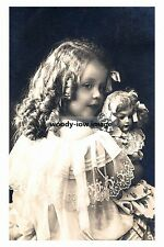 rp10529 - Young Girl with her Doll - photograph 6x4