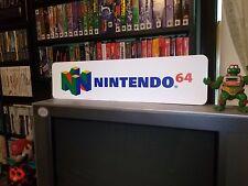 "N64 Display, Nintendo 64, Aluminum Sign, 6"" x 24""."