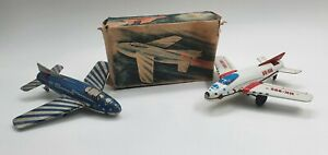 Tin Toy HUKI Wind up  HK-555 Airplane                   -original box-