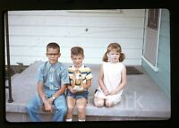 1970  amateur Kodachrome Photo slide Young boys and girl on porch