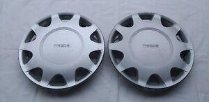 "Mazda 323 Protege NOS Hub Caps 13"" 1990 - 1995 New Genuine Hubcaps Wheel Cover"