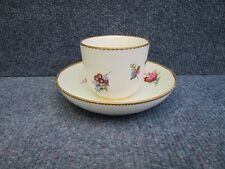 SEVRES PORCELAIN CUP & SAUCER with flowers decorated and gilt border 18th cent.