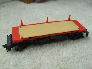 Vintage 1980s HO Scale Tyco Operating Flat Car with Stakes