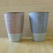 A pair of Japanese tea cup / white based yunomi tea cup with red and blue stripe