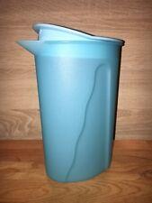 Tupperware jugo. - lata de leche zumo tetera con jarra oval plástico azul