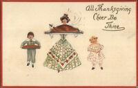 Thanksgiving - Woman & Children Serving Turkey Dinner c1910 Postcard