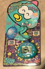 RakuRaku DinoKun Dinkie Dino Electronic Virtual Pet Tamagotchi TK-910 Blue NEW