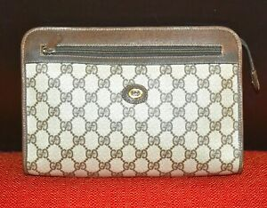 AUTHENTIC, VERY NICE CLASSIC STYLISH GUCCI MONOGRAM CLUTH BAG.