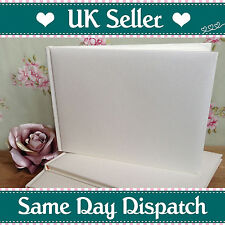 a Ivory Wedding Guest Book With Entwined Silver Rings Ribbon and Pearls
