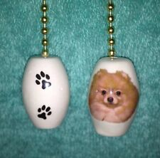 One Pomeranian Dog Fan Pull With Paw Prints On The Back 1""