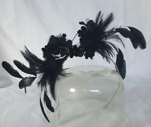A stunning & elegant John Boyd black fascinator with black flowers & feathers