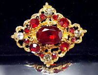 Vintage Ruby glass stone domed brooch.