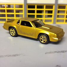 1/64 1984 Hurst Olds Cutlass in Gold with Ghost Flames on Gold Wheels