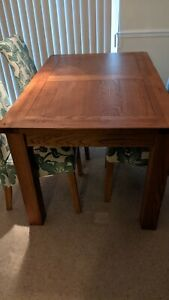 Solid oak  extendable dining table and 4 chairs