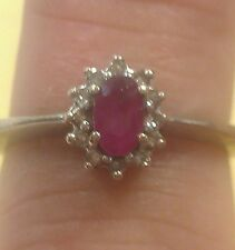 Gorgeous 14 kt. white gold 1/3 ct. Ruby and  diamond ring.