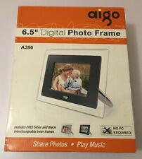 Aigo 6.5 Digital photo frame shows photos and plays music.