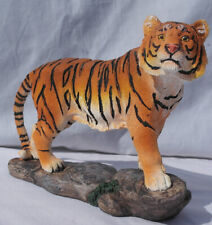 Free standing graceful tiger standing on a rock decorative ornament