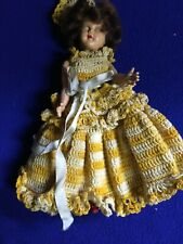 "8"" vinyl doll with movable arms in crocheted dress"
