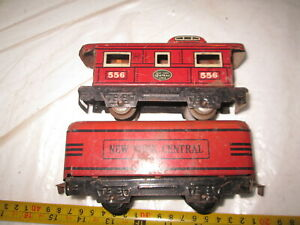 O/O-27 Marx Red New York Central tender and 556 NYC Caboose.