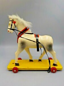 Vintage Erzgebirge Germany Wood Horse Pull Toy on Wheels Hand Crafted