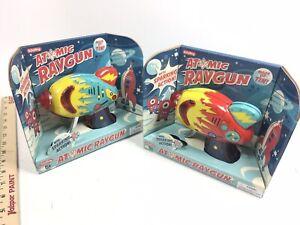 2x Atomic Ray Guns Friction Sparking Tin Litho Blaster Laser Raygun Schylling