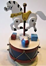 music box A wooden horse on a rotating drum