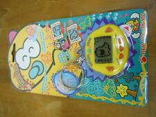 RakuRaku DinoKun Dinkie Dino Electronic Virtual Pet TK-910 Color Yellow NEW