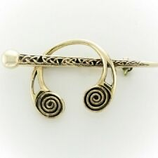 a pin and torc design. Irish Bronze celtic brooch with