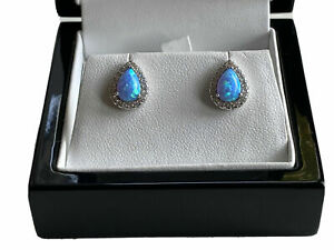 White gold finish turquoise and created diamond Pear Cut stud earrings