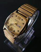 Mens Marcel & Cie Swiss Made Yellow-Gold 1970s Day Date wrist watch.