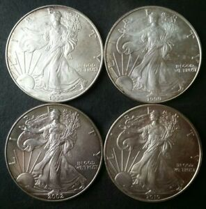 Lot of Four $1 American Silver Eagle Dollars